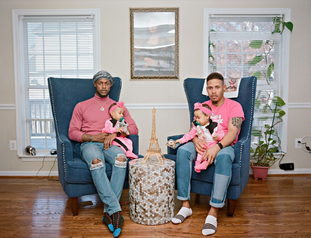 Vernon and Ricardo with their twin girls at home. Clinton, Maryland © Bart Heynen from 'Dads' published by powerHouse Books