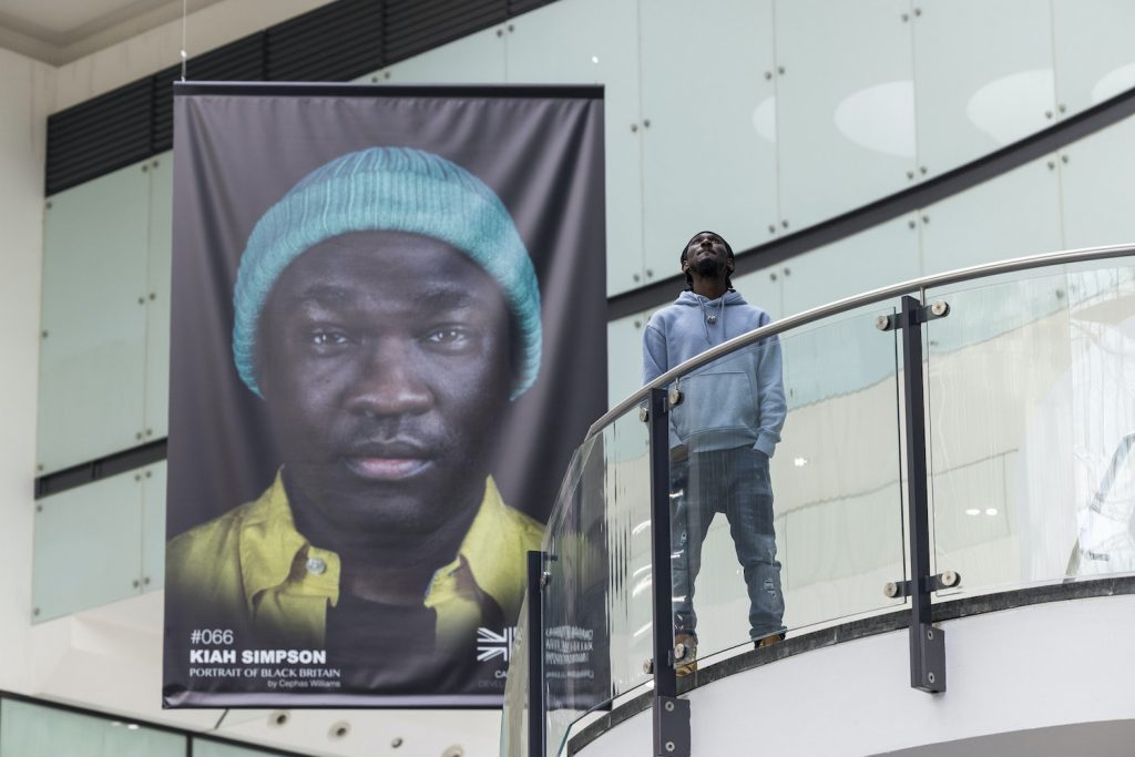 Cephas Williams in front of the installation at the Arndale
