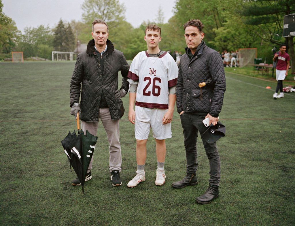 Tom and Mike with their son Jack at a lacrosse practice at Horace Mann School, Bronx, New York